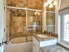 The 3rd floor shared bathroom features a dual vanity & tub/shower combination