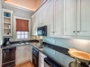 Carriage House Kitchen - Featuring a Stove Top & Dishwasher