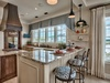 Kitchen - Featuring High End Appliances Including a Gas Range