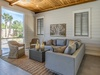 Ample room to lounge around on screened in porch