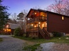 is a four bedroom, two bath log cabin.
