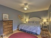 This periwinkle-blue room has a king-sized bed and vintage dresser.