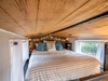 Comfy queen bed in the loft of Redbud