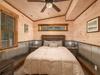 features a cozy queen bed.