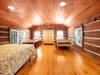 One of two bedrooms on the second level. One queen and two twin beds.