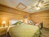 The upstairs Fishing Room features a queen bed, twin bed, and a 24