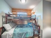 The upstairs bunk room has a bunk bed with a full on the bottom and a twin on the top.