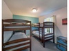The third bedroom has two sets of twin bunk beds.