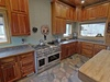 This updated lodge has a great gas range in its fully stocked kitchen.
