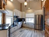 Suite 1 has an open floor plan with a bright, modern kitchen.