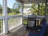 Screened_Deck_off_of_Living_Room_with_Grill