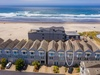 Located steps from the sand in the Seascape townhome complex