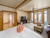 Upstairs: Master Bedroom with access to upper deck