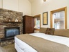Downstairs king bedroom with double-sided fireplace