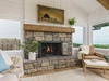 Living Room: Gas fireplace with cozy reading chair