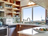 Well-stocked gorgeous new kitchen with ocean view