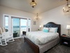 Luxurious master suite includes a private balcony, en suite bath, and cable TV