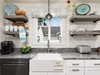 Shiplap and a farmhouse sink with granite countertops and open shelving. Perfection!