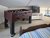 Hip upstairs kid's pad with Foosbal table, TV and DVD/VHS player