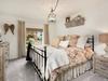 The idyllic master bedroom has an en suite bath and flatscreen TV