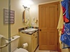 Full bathroom with tub/shower enclosure and soft plush towels