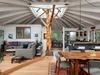The petrified tree and massive skylight steal the show in this open concept upper level living area