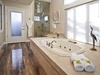 Master spa suite includes a steam shower, soaking tub, plush towels, and direct access to hot tub.