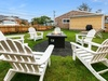 With the kind of grass you can't wait to get your bare feet in the large fenced back yard has a fire pit and BBQ