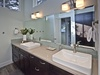 Upstairs light-filled bathroom with double vanity and separate water closet and walk-in shower
