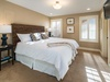 King bedroom with plush mattress and cotton linens, and en suite bathroom