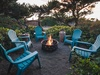 At night grab a glass of wine and relax around the fire pit