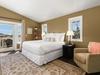 King bedroom with sliding door to balcony