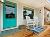 Farmhouse rockers by the front door are great way to relax after a day at the beach