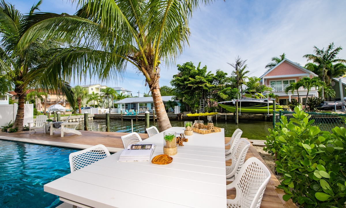 Pool Deck Dining Table, Pirate's Cove - AMI Locals