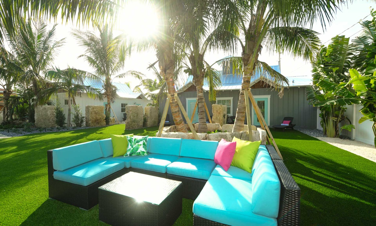 Outdoor Living Room at Island West Resort, Villa Limefish - AMI Locals