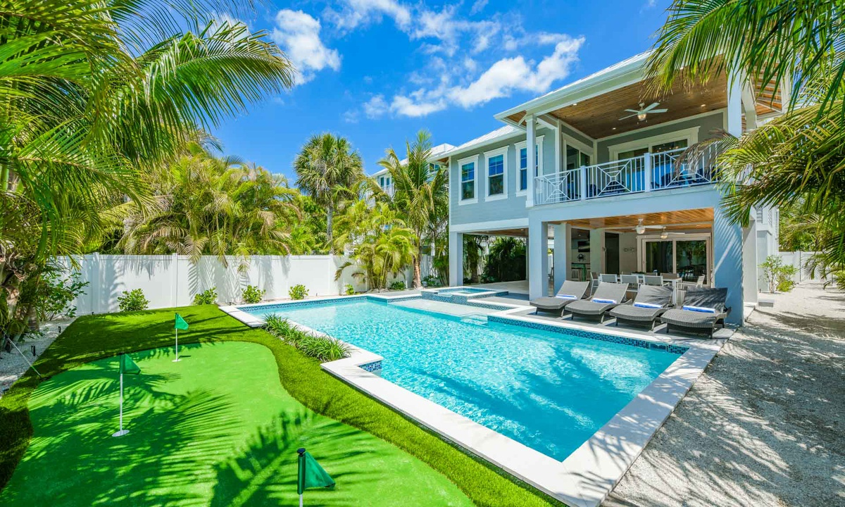 Putting Green and Pool area, Anna Maria Beach House - AMI Locals