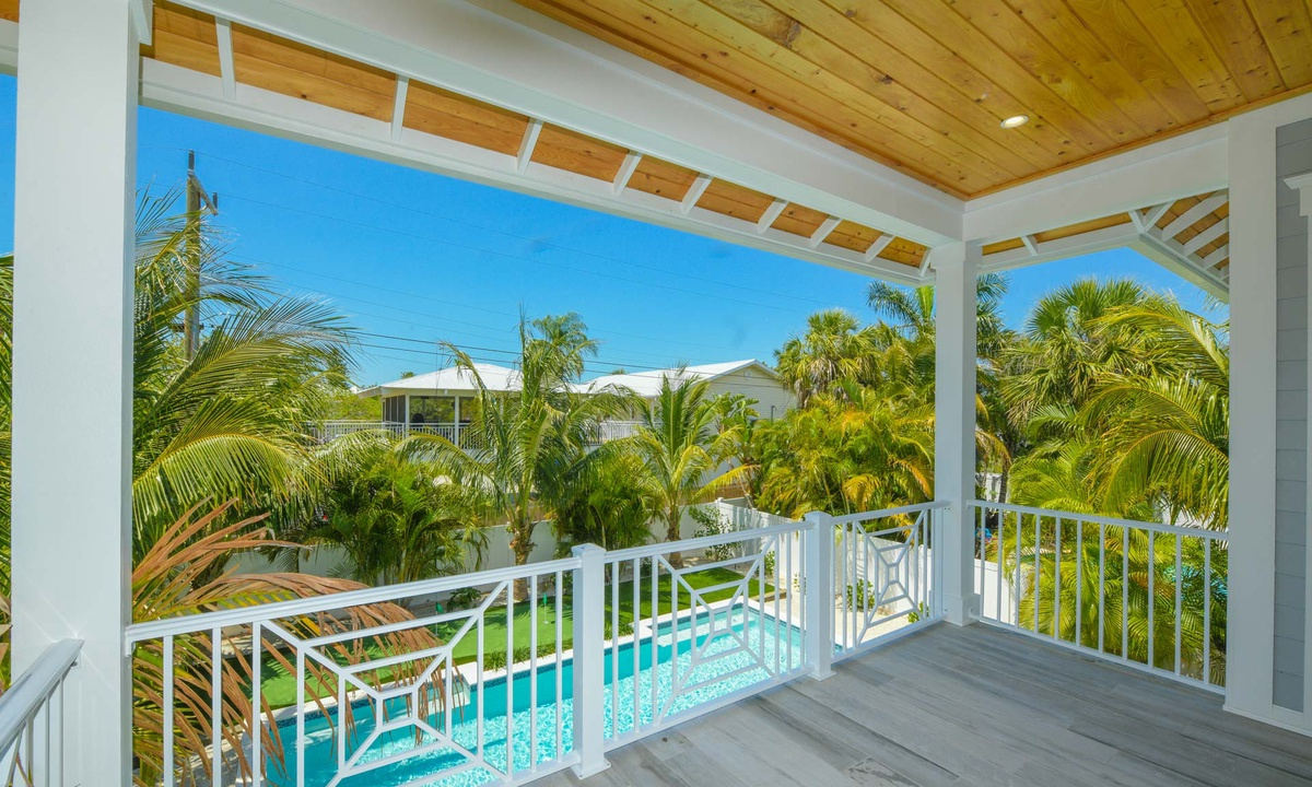 Deck overlooking the Pool, Anna Maria Beach House - AMI Locals