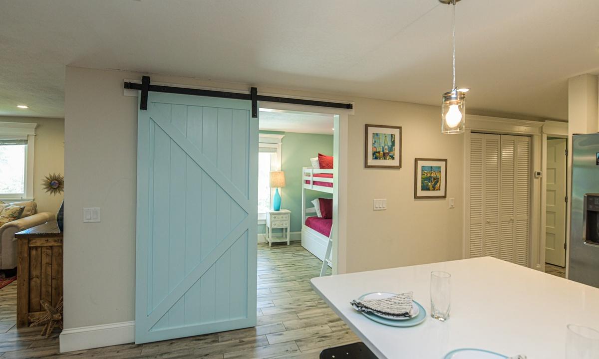 Barn Door to Bedroom 2, Blissful Bay - AMI Locals