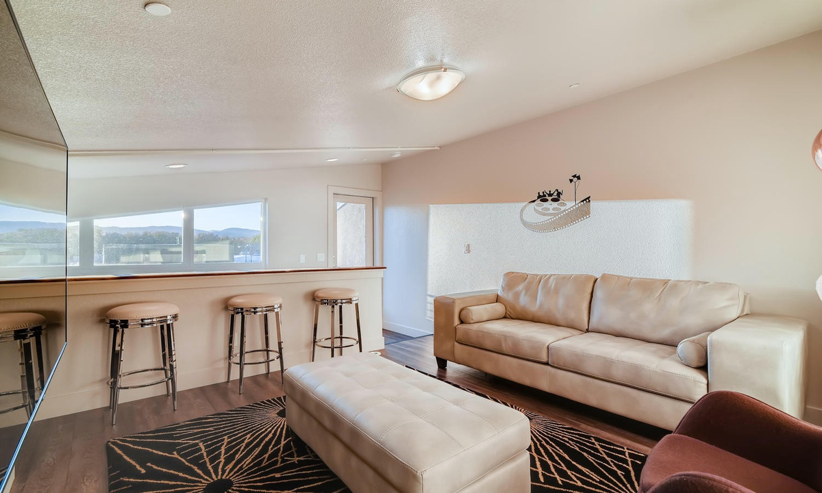 3rd floorLoft/ family room with Queen sleeper sofa and access to rooftop deck