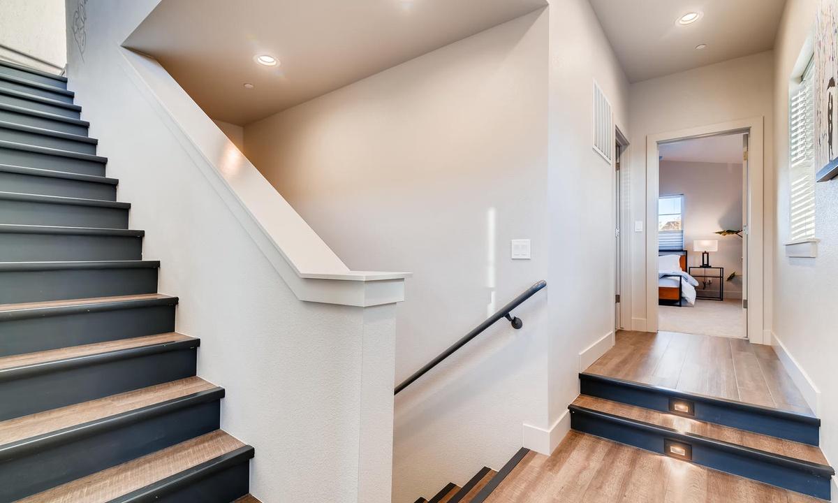 Stairway to loft and rooftop deck. Landing on second floor
