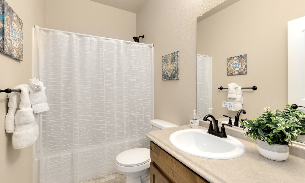 Shared bathroom with tub/shower combo