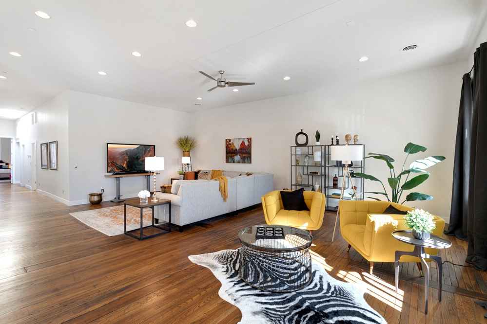Living room with plenty of seating and Smart TV for your use.