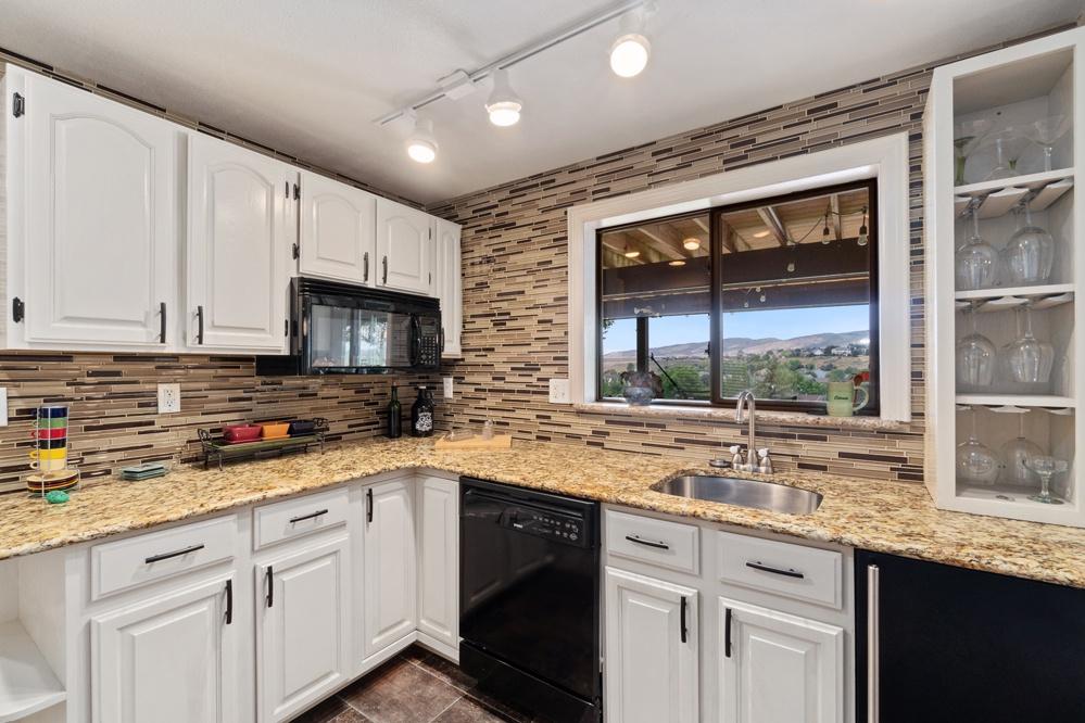 Full kitchen on lower level.