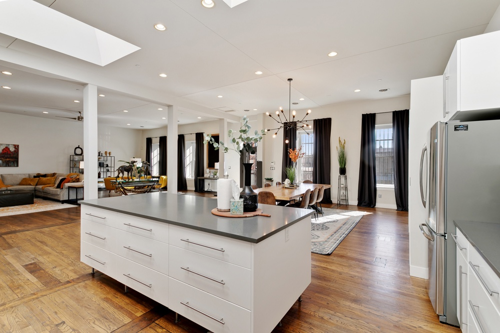 Beautiful Chef's kitchen with stainless steel appliances. Large window that look out onto the deck