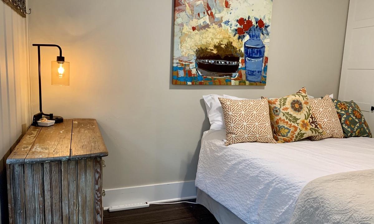 Queen size bed in bedroom. Second bed is air mattress