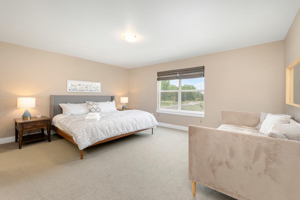 Bedroom 2: King bedroom with ensuite bath upstairs