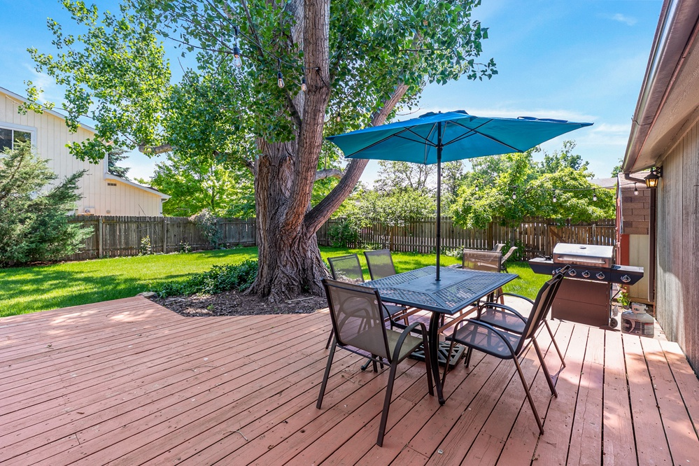 outdoor seating for grilling out and enjoying the large backyard.