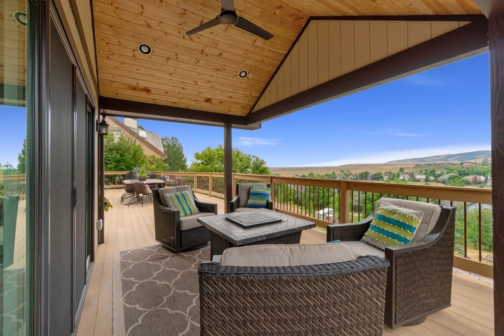 Beautiful covered deck with firepit and incredible views of the foothills