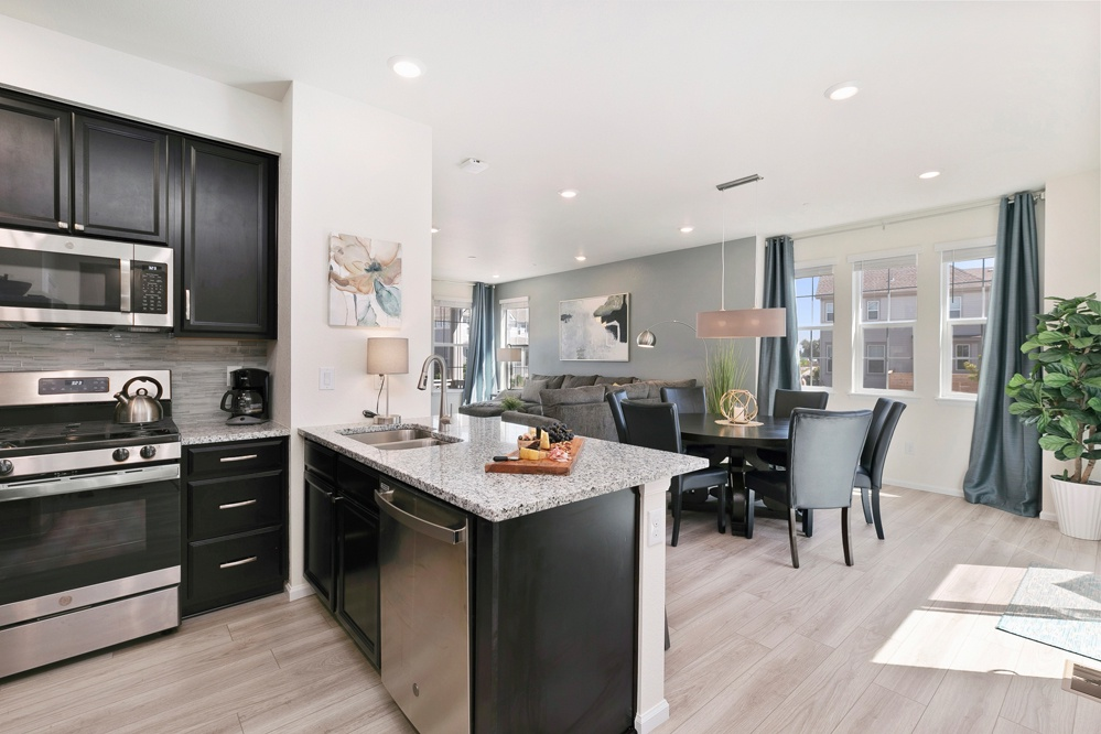 Kitchen opens to bartop and dining area