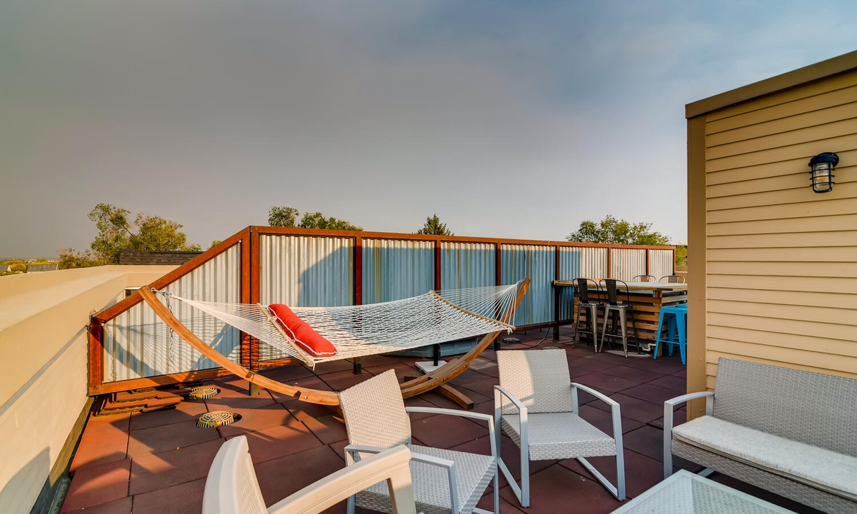 Rooftop deck/terrace with hammock and seating areas
